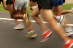 Runners legs. On the road with panning blur Royalty Free Stock Photo