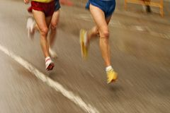 Runners legs. On the road with panning blur Royalty Free Stock Image