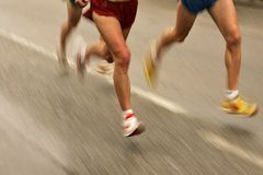 Runners legs. On the road with panning blur Stock Images