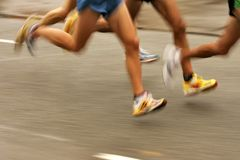 Runners legs. On the road with panning blur Royalty Free Stock Photography