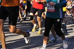 Runners legs  of the half marathon Royalty Free Stock Images