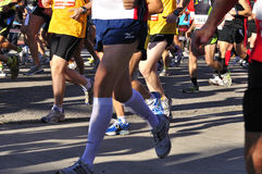 Runners legs  of the half marathon Stock Photography