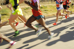 Runners. Legs on the road with panning blur Stock Photography