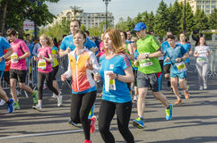 Runners at marathon. Amateur runners racing on marathon during the International Half Marathon competition on May 18, 2014 in Bucharest, Romania. The Bucharest Royalty Free Stock Images