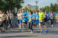 Runners at marathon. Runners participate in half marathon on May 18, 2014 in Bucharest, Romania Stock Photos
