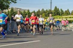 Runners during marathon. Runners racing in the Bucharest International Half Marathon taken place on May 18, 2014 in Bucharest, Romania Stock Image