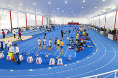 Runners. At a national indoor contest in 2015 from Bucharest, Romania interior tamrac bend start judge referee Stock Image