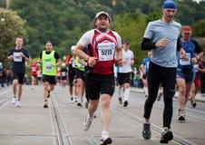 Runners on Palackého bridge of PIM Stock Photo