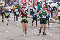 Runners Pass through Pinetown During Comrades Marathon Royalty Free Stock Images