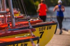 Runners pass by sailboats along Lake Mendota, Madison, Wisconsin. Runners pass by sailboats along Lake Mendota in Madison, Wisconsin royalty free stock photo