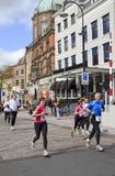 Runners passing Bellevue Groothoofd hotel Royalty Free Stock Photo