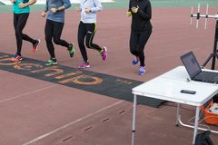 Runners passing a time checkpoint Stock Photography