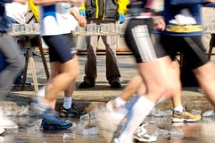 Runners Passing Water Stand Stock Images