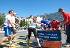 Runners picking water at refreshment point at marathon run in Belgrade, Serbia Stock Photography