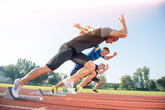 Runners preparing for race at starting blocks.  royalty free stock image