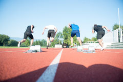 Runners preparing for race at starting blocks Royalty Free Stock Photography