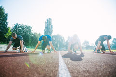 Runners preparing for race at starting blocks Royalty Free Stock Photo