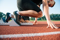 Runners preparing for race at starting blocks Stock Photography