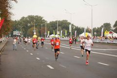 Runners prior Large group of runners gathered outdoors to participate in the annual Minsk half marathon on September 9, 2018. Royalty Free Stock Images