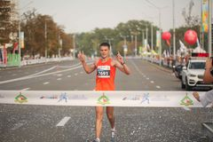 Runners prior Large group of runners gathered outdoors to participate in the annual Minsk half marathon on September 9, 2018. royalty free stock image