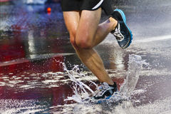 Runners puddle Stock Photo