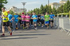 Runners during the race. Marathon runners competing on the streets of Bucharest at the International Half Marathon on May 18, 2014 in Bucharest, Romania Royalty Free Stock Photography