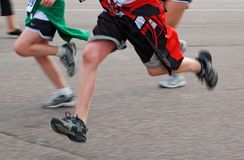 Runners Race Past Royalty Free Stock Photography