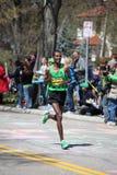 Runners race up Heartbreak Hil Royalty Free Stock Photo