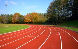 Runners racetrack surrounded by trees Royalty Free Stock Image