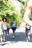 Runners racing in marathon Royalty Free Stock Image
