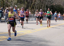 Runners ran up Heartbreak Hill during the Boston Marathon April 18, 2016 in Boston. Royalty Free Stock Image