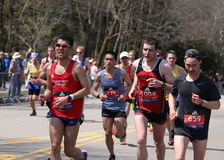 Runners ran up Heartbreak Hill during the Boston Marathon April 18, 2016 in Boston. Royalty Free Stock Photography