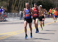 Runners ran up Heartbreak Hill during the Boston Marathon April 18, 2016 in Boston. Royalty Free Stock Images
