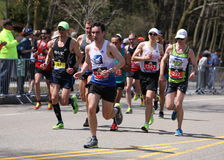 Runners ran up Heartbreak Hill during the Boston Marathon April 18, 2016 in Boston. Stock Images