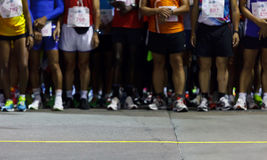 Runners ready to run at starting point Royalty Free Stock Photography
