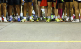 Runners ready to run at starting point Royalty Free Stock Photo
