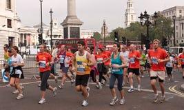 Runners in the Royal Parks Half Marathon, London. Runners in the  Annual Royal Parks Foundation Half Marathon, Run Past  Trafalgar Square. October 10 2010 Royalty Free Stock Photo