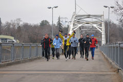 Runners is running on the bridge Royalty Free Stock Images