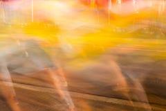 Runners running in city marathon, motion blur on sporty legs Stock Photo