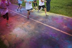 Runners running in a color run race abstract photo Stock Images