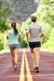 Runners running and jogging for health and fitness. People on fitness run on road in nature. Couple, women and men training outside for fitness and healthy stock photo