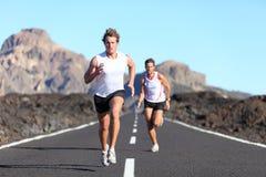 Runners running on road