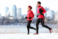 Runners running in winter city Royalty Free Stock Image