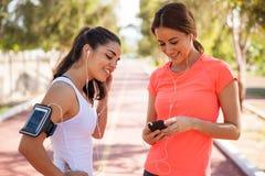 Runners sharing music Stock Photos