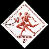 Runners, Sport serie, circa 1964. MOSCOW, RUSSIA - FEBRUARY 21, 2019: A stamp printed in Hungary shows Runners, Sport serie, circa 1964 royalty free stock photography
