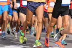 Runners with sportswear and running shoes during the marathon Royalty Free Stock Photography