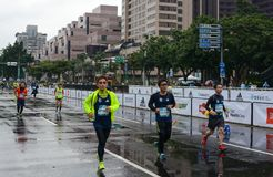 Runners sprint down the final stretch of road in the 2017 Taipei International Marathon Stock Image