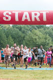 Runners Sprint Off Start Line In Extreme Obstacle Course Race Royalty Free Stock Image
