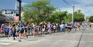 St Jude Rock n Roll Half Marathon Runners Near Finish Line. Runners in the 2019 St. Jude Rock n Roll Half Marathon in Nashville, Tennessee, round the corner to royalty free stock image