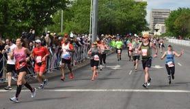 St Jude Rock n Roll Half Marathon Runners Near Finish Line. Runners in the 2019 St. Jude Rock n Roll Half Marathon in Nashville, Tennessee, round the corner to stock photos